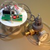 Photocell-controlled CO2 release